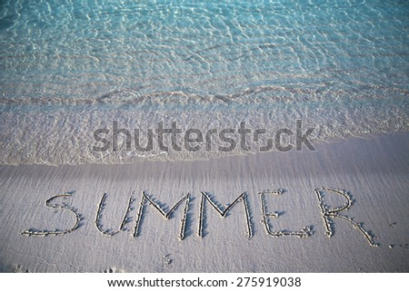 Word summer written on the sandy beach - stock photo