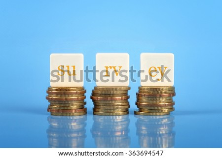 Word SURVEY on stacked coins,business conceptual.