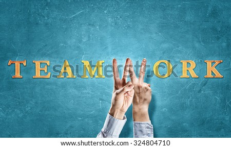 Word teamwork with fingers instead of letter W - stock photo