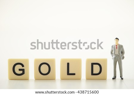 Word tiles gold with miniature man