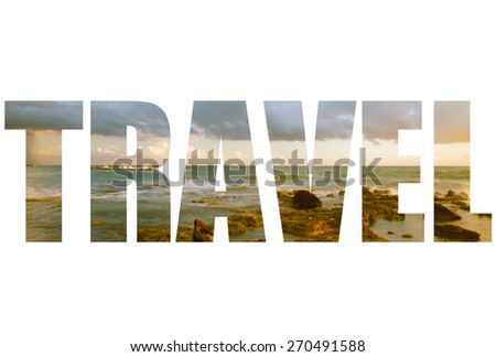 Word TRAVEL over Seascape  with low clouds above the stony shore of the sea - stock photo