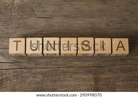 word tunisia on a wooden cubes - stock photo