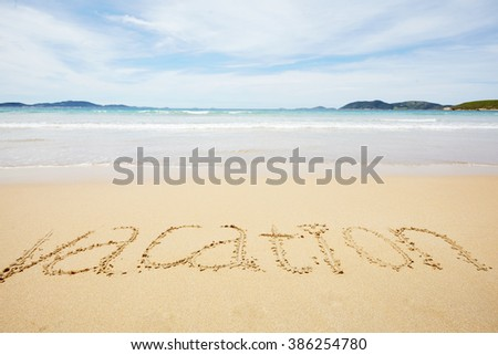 Word Vacation on a sand on a tropical seashore - stock photo