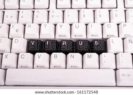 Word Virus written with black keys on computer keyboard. - stock photo