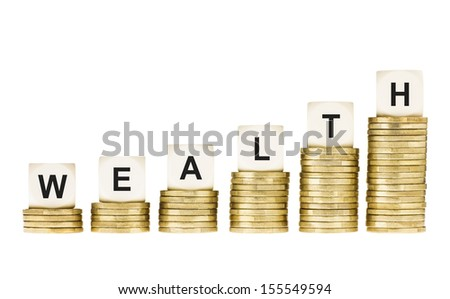 Word WEALTH on Row of Gold Coin Stacks Isolated White