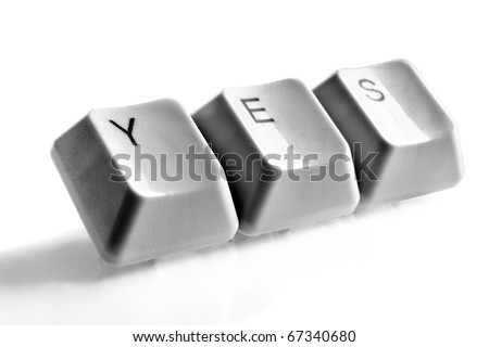 Word 'yes' made from computer keyboard keys - stock photo