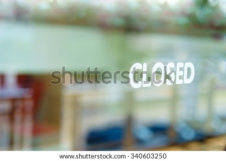 "Wording ""closed"" white sticker on clear glass selective focus. - stock photo"