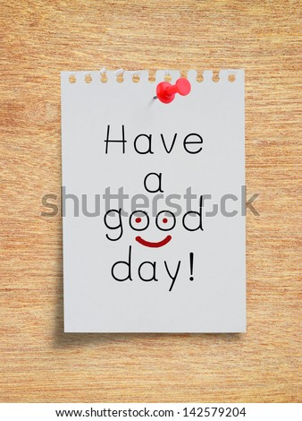 Wording, Have a good day, on white torn paper note with red pushpin on plywood board - stock photo