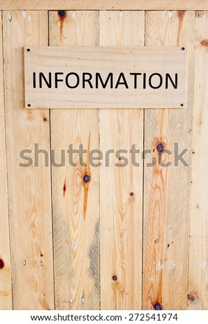 Wording Information sign on wood board.