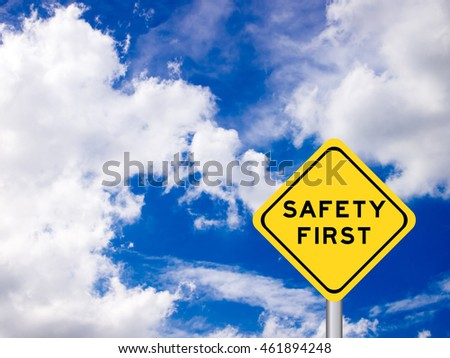 "wording ""Safety first"" on yellow traffic sign on the blue sky"