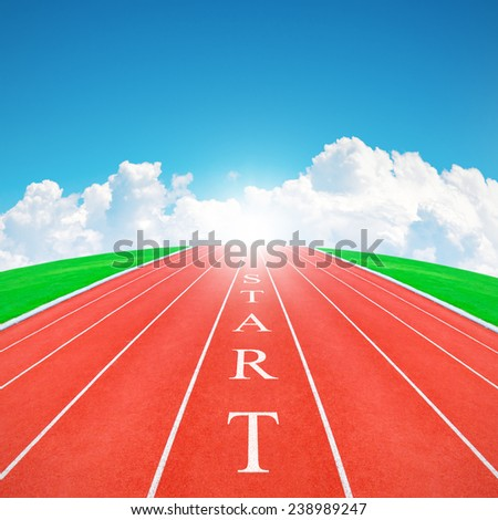Wording START on running track in blue sky and clouds