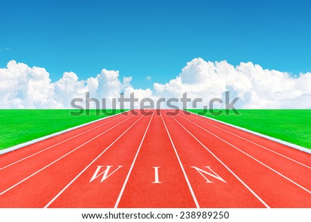 Wording WIN on running track in blue sky and clouds