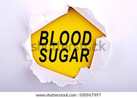 Words Blood Sugar on ripped paper - Business, technology, internet concept. Stock Photo