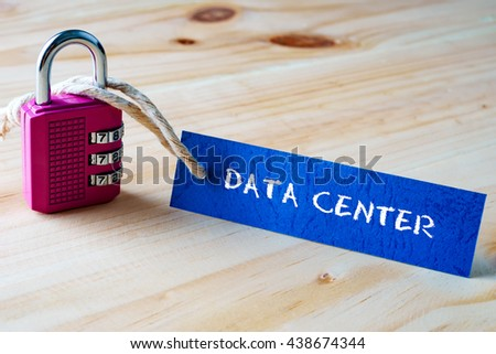 Words DATA CENTER written on tag label tied with a padlock. - stock photo