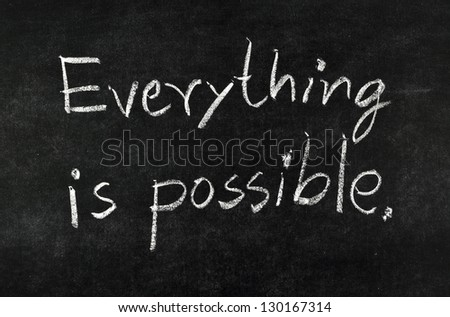 "words ""Everything is possible"" written on blackboard - stock photo"