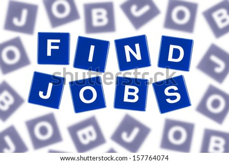 Words FIND JOBS in Clear Focus Against Blurred Letters - stock photo
