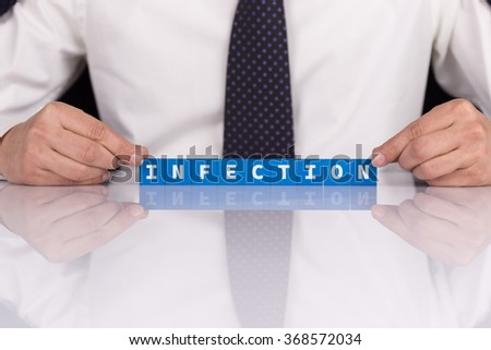 Words INFECTION with blocks - stock photo