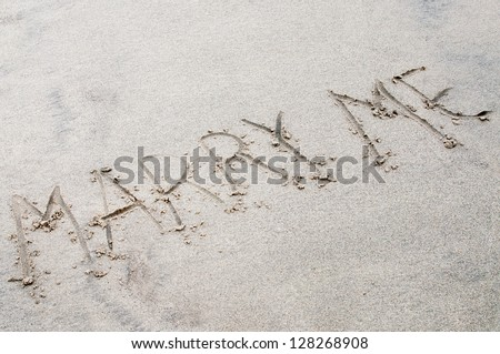 """words """"marry me """" written in the sand - stock photo"""