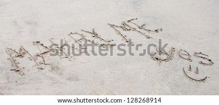 """words """"marry me  yes """" written in the sand - stock photo"""