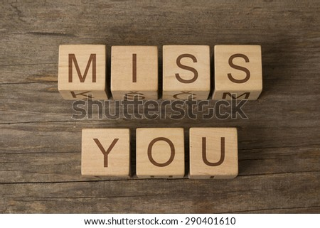 Words miss you on a wooden cubes - stock photo