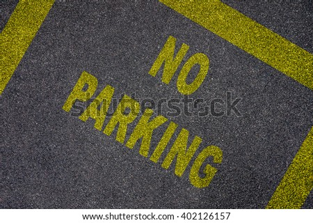 Words No Parking on the road