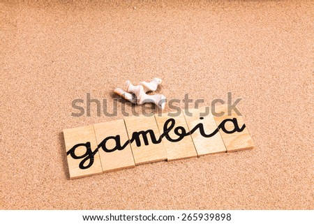 Words on sand gambia - stock photo