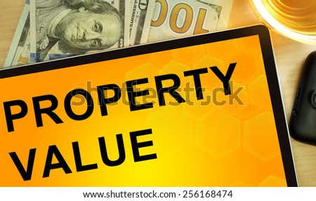 Words property value  on tablet. Business concept. - stock photo