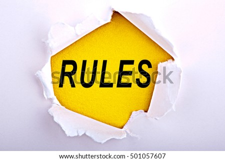 Words rules on ripped paper - Business, technology, internet concept. Stock Photo