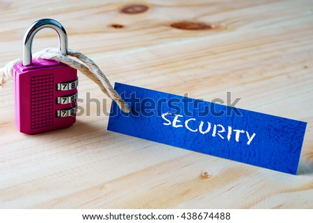 Words SECURITY written on tag label tied with a padlock. - stock photo