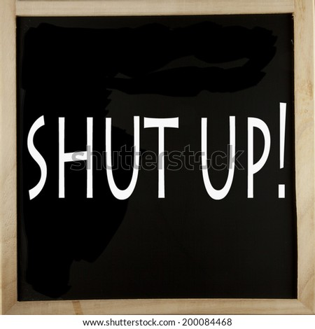 """Words """"Shut up"""" written with chalk over a blackboard - stock photo"""