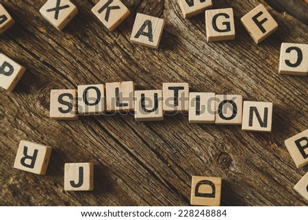 Words, solution. Toy bricks on the table - stock photo