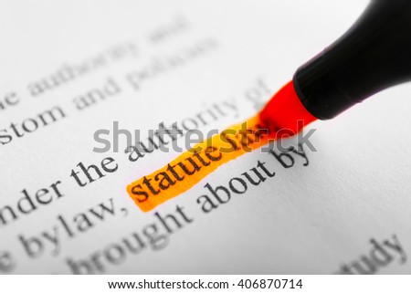 Words Statue law highlighted with an orange marker - stock photo