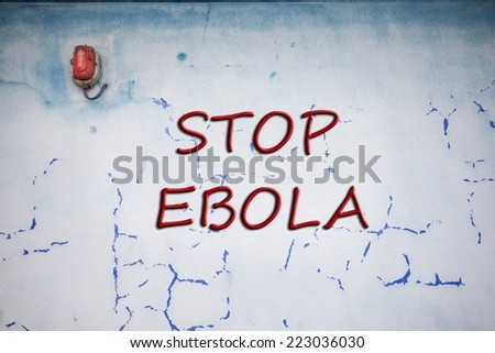 Words Stop Ebola over grunge background wall - stock photo