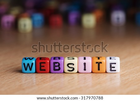 words website with dices on wooden table - stock photo