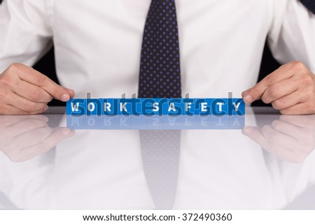 Words WORK SAFETY with blocks - stock photo