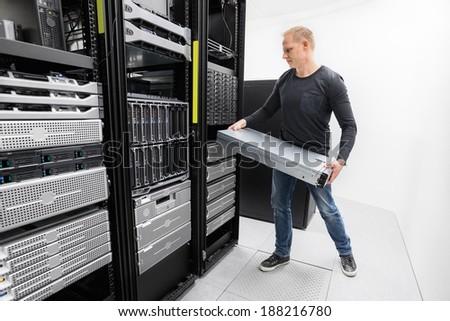 Woring IT consultant install rack server - stock photo