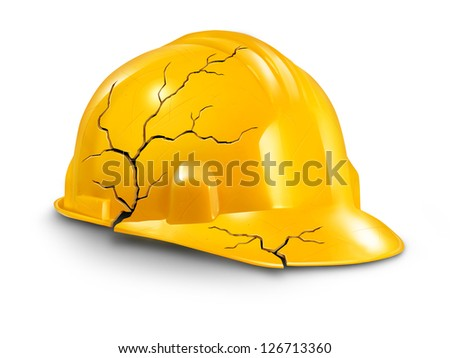 Work accident and health hazards on the job as a broken cracked yellow hardhat helmet as a symbol of working injury and insurance claims from physical damage and pain to the worker. - stock photo