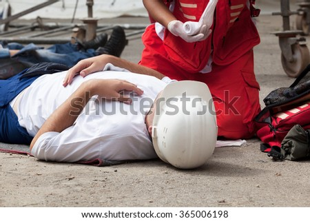 Work accident. First aid training. - stock photo