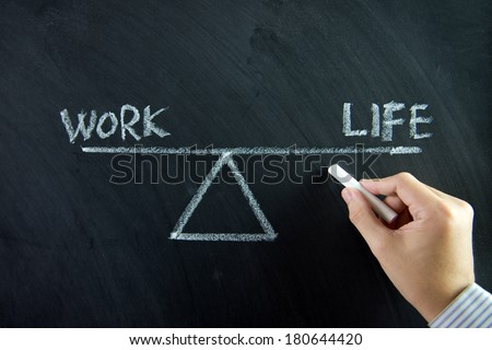 Work and life balance written on chalkboard - stock photo