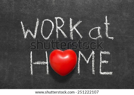 work at home phrase handwritten on blackboard with heart symbol instead of O