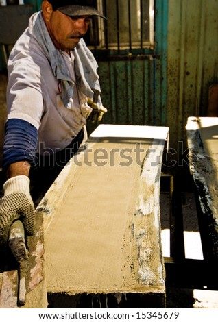 Work at the masonry factory, production of building materials. - stock photo