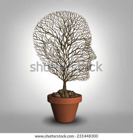 Work burnout and job stress concept due to physical and emotional exhaustion from overwork or career anxiety as an empty tree shaped as a human head with no leaves as a distress and grief metaphor. - stock photo