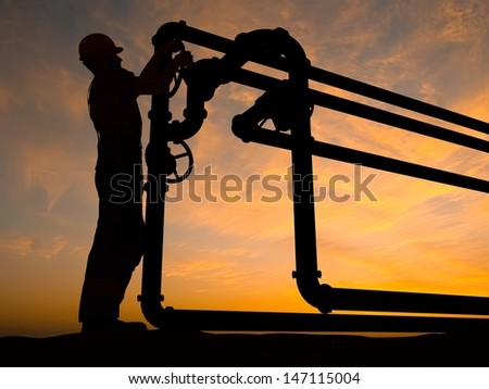 Work closes the valve on the tube. - stock photo