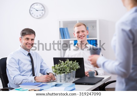 Work colleagues are talking during their working time - stock photo