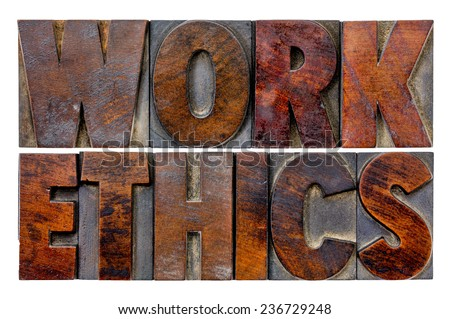 work ethics word abstract in vintage letterpress wood type blocks with ink patina - stock photo
