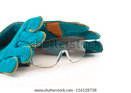 Work gloves and safety glasses on a white background - stock photo