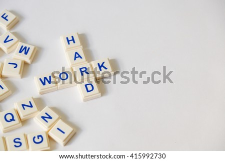 WORK HARD word written on plastic blocks, white background with copyspace