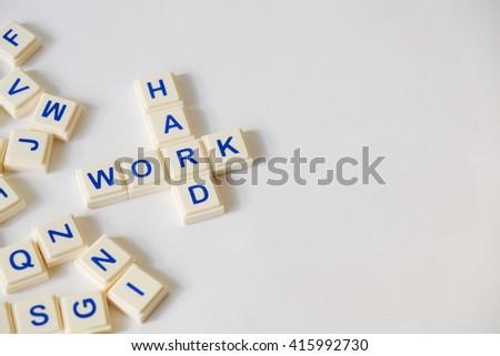 WORK HARD word written on plastic blocks, white background with copyspace - stock photo
