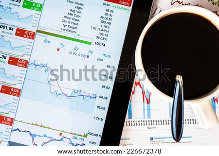 Work in the office, coffee cup with tablet pc - stock photo