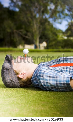Work Life Balance Sees A Man Take A Break To Lie Down And Relax On A Golf Course With A Tee And Golf Ball In His Mouth Balancing The Act Of Work And Play
